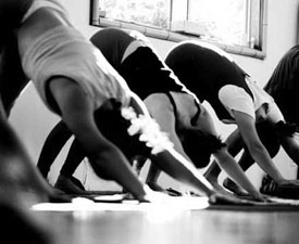 Black and white image of women in a yoga class